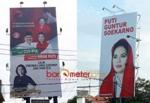 TAK KUNJUNG DIEKSEKUSI: APK liar bergambar Gus Ipul-Puti Guntur masih terpasang di sejumlah titik strategis di Surabaya. | Foto: Barometerjatim.com/ABDILLAH HR