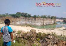 KUBANGAN MAUT: Lokasi kubangan bekas tambang galian C di Desa Wadeng Sidayu Gresik yang menelan korban jiwa. | Foto: Barometerjatim.com/ DIDIK HENDRIYONO