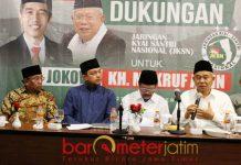 FOKUS DI JKSN: Kiai Asep (kanan) dan Haji Masnuh (kiri), tolak masuk TKD Jokowi-Ma'ruf di Jatim dan pilih fokus di JKSN. | Foto: Barometerjatim.com/ROY HASIBUAN